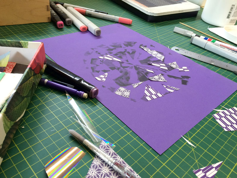 The making of a diamond collage with markers and paper.