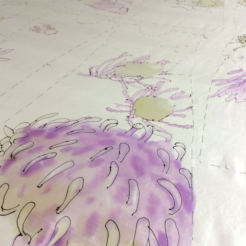After the gutta outline is applied the first layers of silk dye can be brushed on.